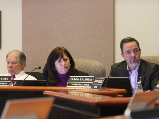 Commissioners Nadia Sikes and Jason Baldwin listen during the City Commission's discussion of the location of the Family Fun Center.
