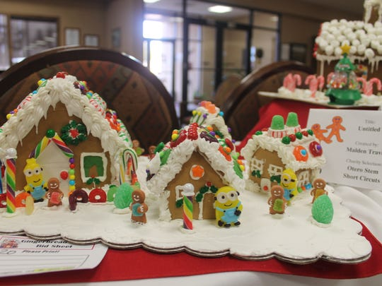 This gingerbread house was constructed by Malden Travis. This entry is No. 20 and proceeds will benefit the Otero STEM Short Circuits.