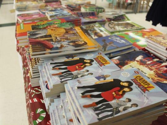 Tables of books were free to kids that came to the One Child at a Time event on Saturday.