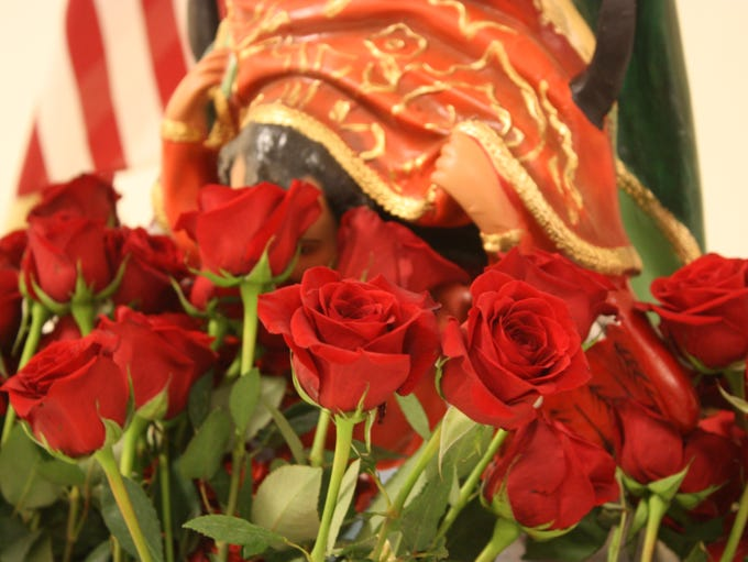 Fresh roses surrounded the statue of the Virgen de