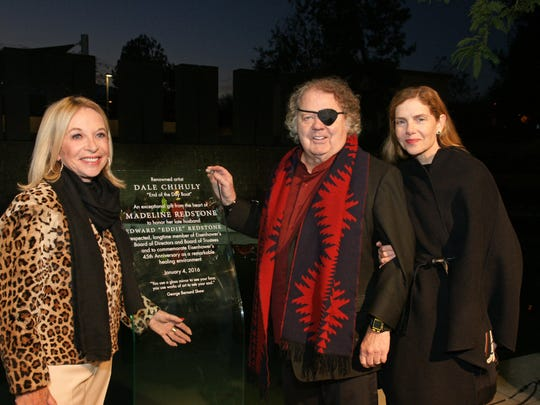 "Philanthropist Madeline Redstone, who gifted ""End of the Day Boat"", reveals the dedication plaque to artist Dale Chihuly and wife Leslie."