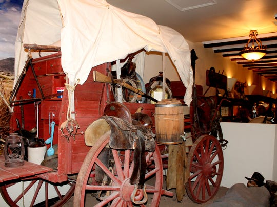 An old-fashioned wagon sits on display at the new Tularosa