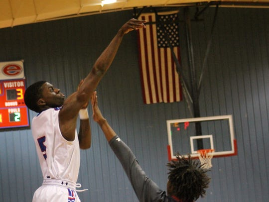Malik Cooper(5) from Evangel jumps and shoots for the