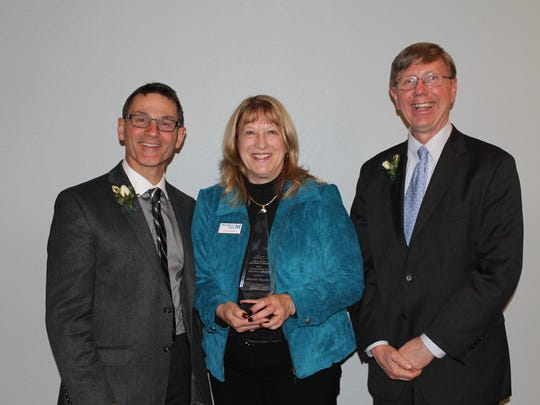 Recipient of the 2015 Volunteer of the Year was recognized during the AC's Annual Meeting. Pictured, from left, are: Tom Schneider, 2016 AC board chair; Marcia Snyder of Hometown Bank; Rick Parks, 2016 AC past chair.