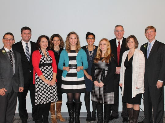 In recognition of the innovative learning environment created within the STEM Academy and STEM Institute through the partnerships developed with area businesses. Pictured, from left, are: Tom Schneider, 2016 AC board chair; Don Smith, Nicole Mashock, Jenny Hughes, Katie Kujawski, Carlie Stigler, Bobbi Mand, Dr. Sebert, Kim McGrath, all of STEM Academy, and STEM Institute; Rick Parks, 2016 AC past chair.