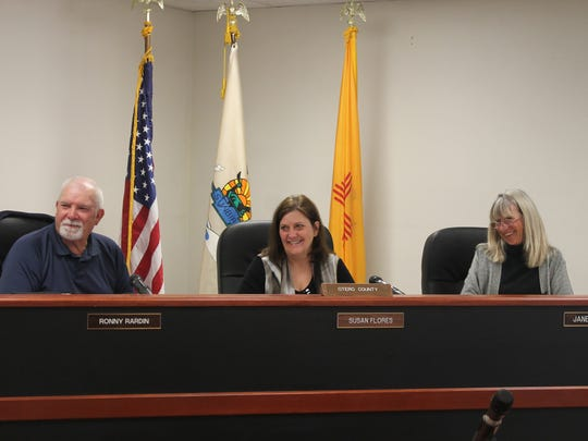 Otero County Commissioners  from left to right: Ronny Rardin, Susan Flores and Janet White have a laugh as they discuss the future of the solar farm at the Otero County Prison Facility at their Feb. 11 meeting.