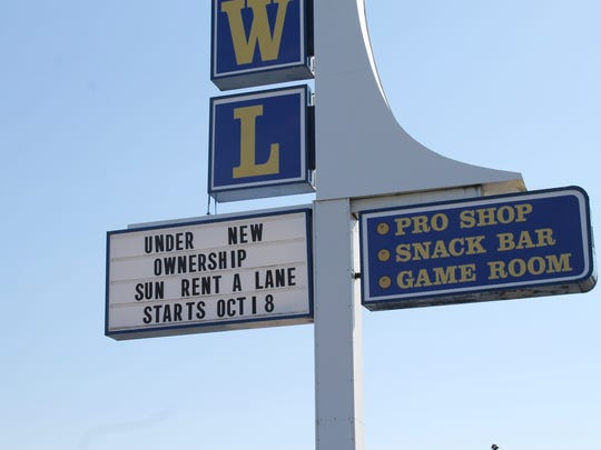 The sign in front of Cherokee Lanes confirms the change in management.