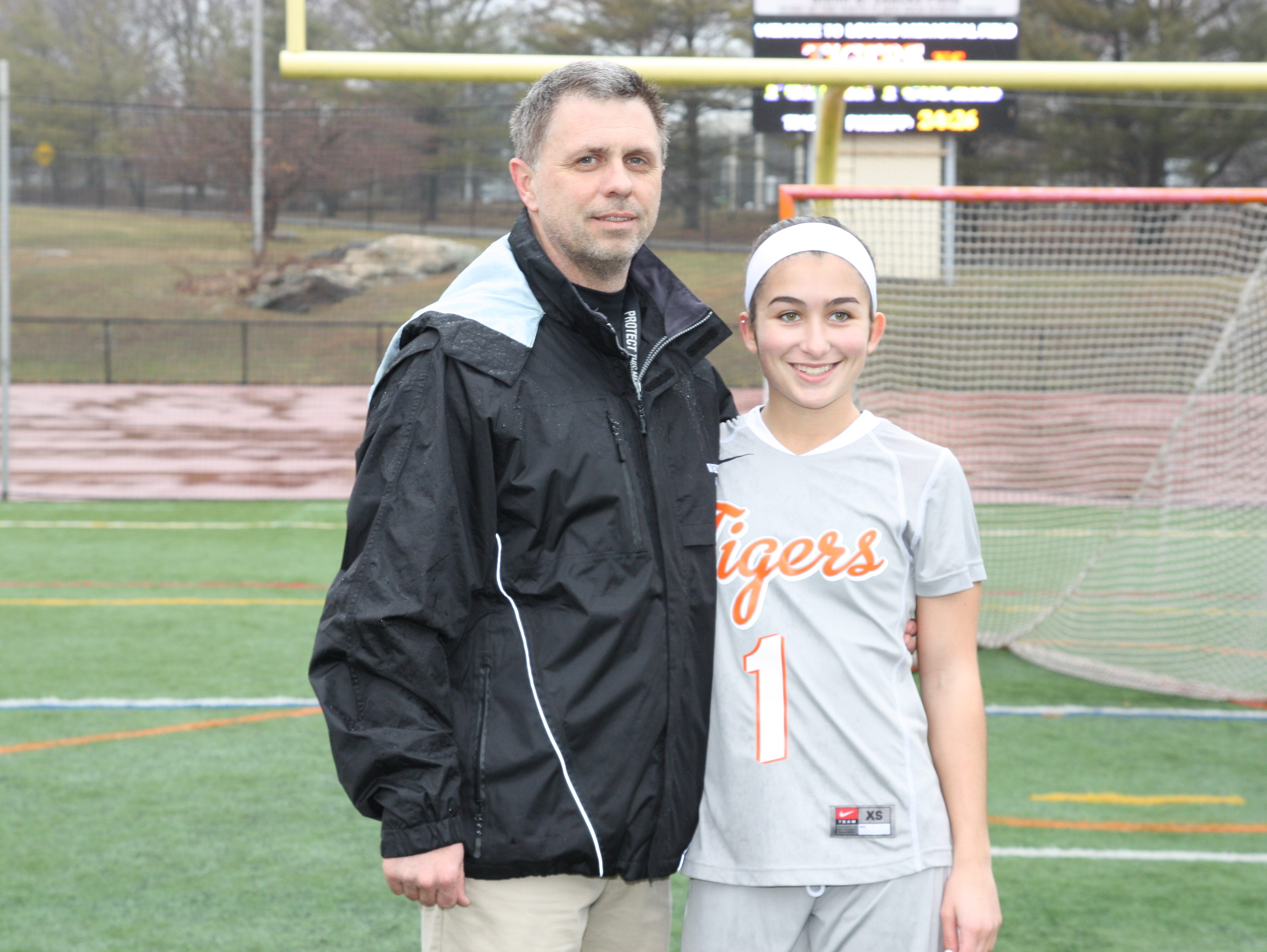 White Plains girls lacrosse head coach Mike Leone, pictured here with former varsity player Erin McGee, passed away on Thursday, April 7th, 2016. He was 49 years old.