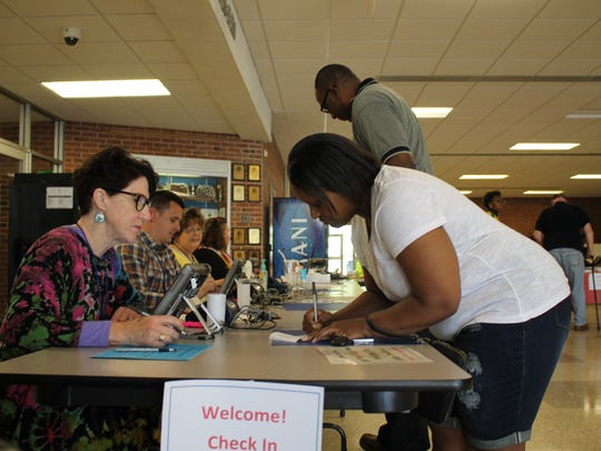 Voters sign in at Wicomico High School, ready to cast their ballots.