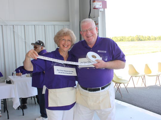 Jackie Neff and Paul Mruk selling 50/50 tickets at last year's fundraiser. There will be another 50/50 drawing this year (50 percent goes back to the center and 50 percent goes to the winner).