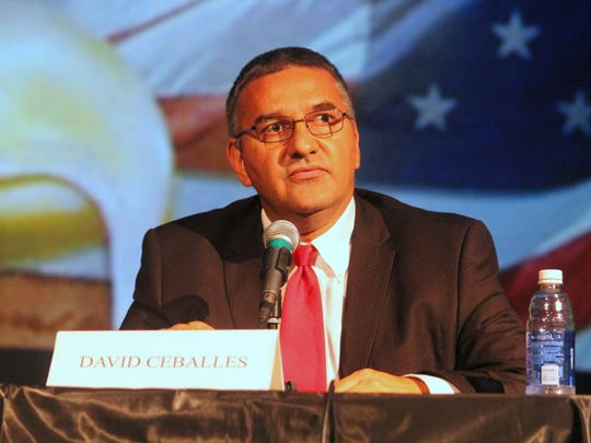 Twelfth Judicial District Attorney incumbent David L. Ceballes answers a question during a televised debate at the Historic Sands Theater last Thursday.