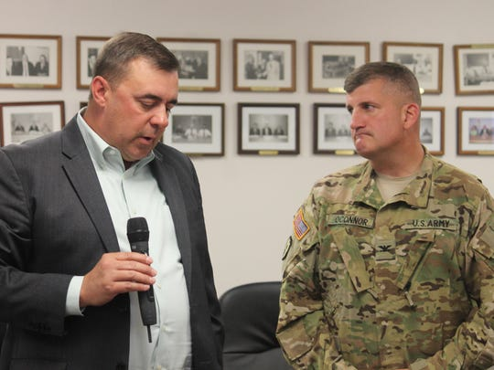 Conservation Branch Chief of the Environmental Division at Fort Bliss Brian Knight and Col. Tom O'Connor, Commander of the Combat Aviation Brigade explain to Otero County Commissioners their proposal to fly in Otero County for a specialized training involving high altitude landing.