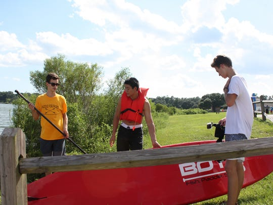 William Langhorne (left), Tristan Wu (center) and Paul Vinson prepare for Paddle for Packs in this photo from August. The fundraiser brought in about $2,500 for the Escambia County Backpack Project.