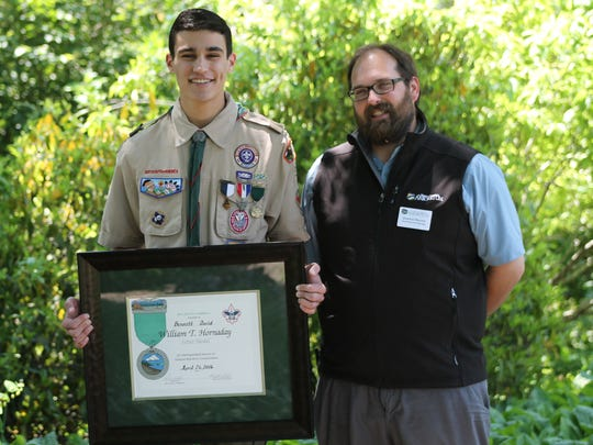 Bennett David, left, with his adviser Jonathan Marchal of the N.C. Arboretum, is presented with the prestigious William T. Hornaday Silver Medal in Conservation.