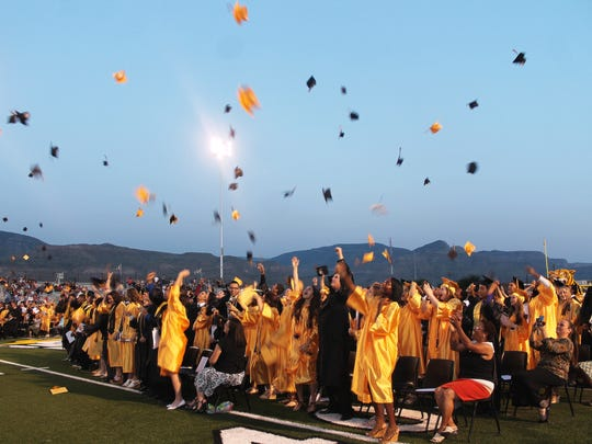 Alamogordo High School graduates throw their mortarboards into the sky after being certified by Board of Education President David Weaver.