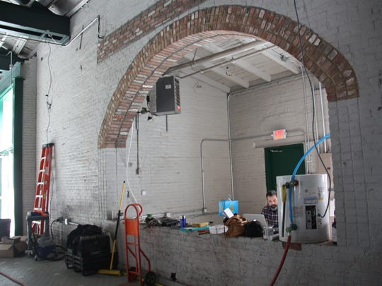 An archway constructed from the building's original bricks will be home to the tasting area at Industrial Arts Brewing Co.