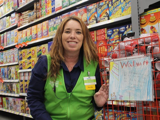 Store Manager Donna Sauter is proud of the artwork Sierra Elementary School students made for the new Walmart. Multiple piece of art are displayed on the end caps of aisles.
