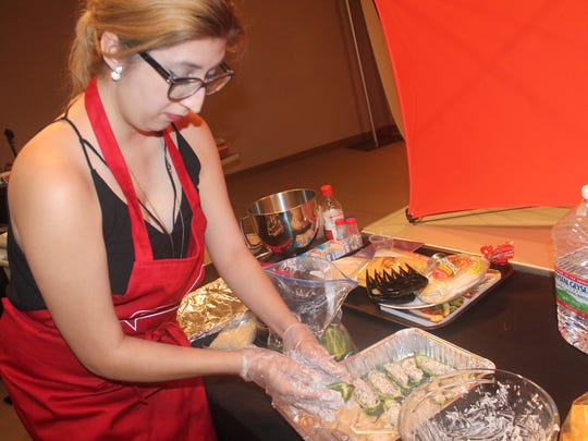 Daily News reporter Jacqueline Devine prepares food during a cooking segment.