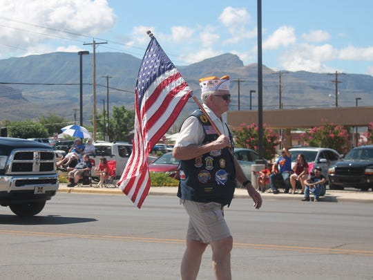 A local veteran walks the parade route during the Fourth