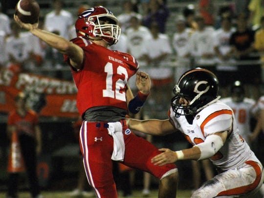 Evangel quarterback Connor Curry makes a quick throw during a playoff game last season.
