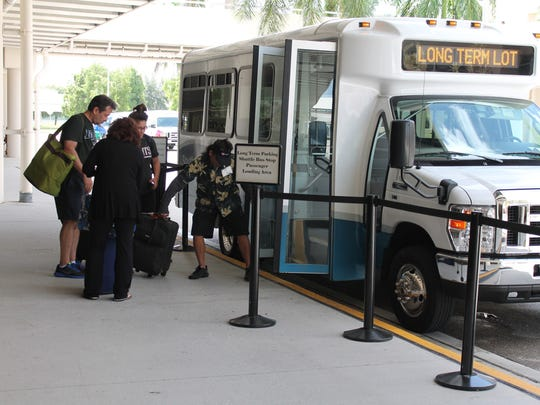 Shuttle buses take travelers to and from the terminal