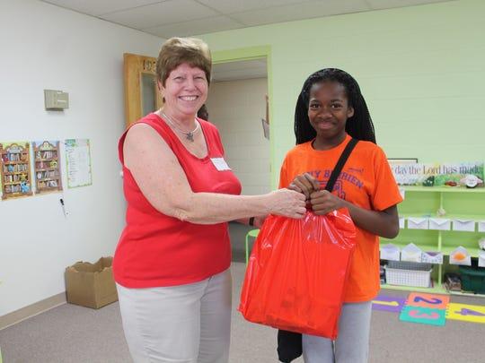 Ciara Richardson, 7th grade, picks up a bag of school supplies on Saturday morning.