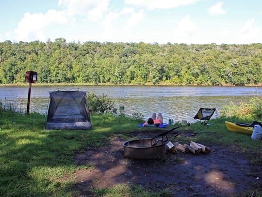 Dozens of riverside campsites are scattered along the St. Croix National Scenic Riverway. The campsites are free and open to paddlers and boats only on a first-come, first-serve basis. This site, at river mile 58.5 a few miles north of St. Croix Falls, provides a wide-open view of the St. Croix River.