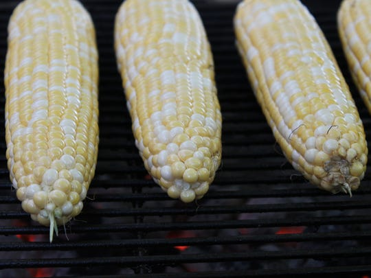 Strip your corn down and throw it on the grill. It's allowed.