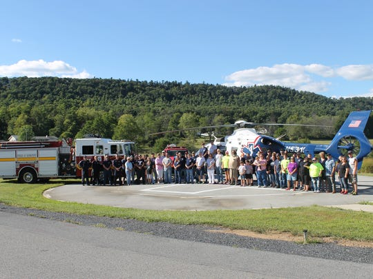 Attendees at the EMS picnic posed for a group photo with the Air Methods flight crew who flew in for the event.