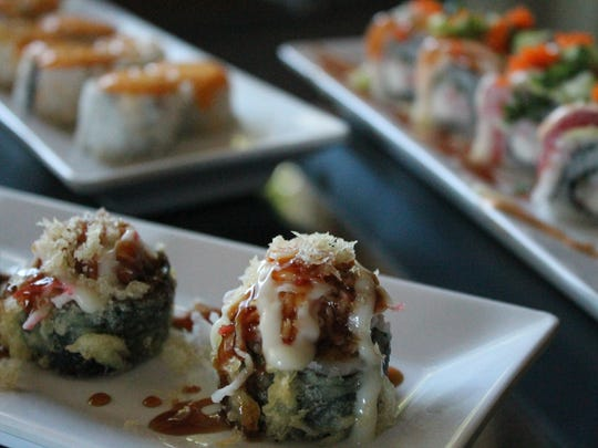 The Krabby Patty (front) is the most popular roll at Island Sushi. The Big Kahuna (right) and Hidden Gem are also popular.