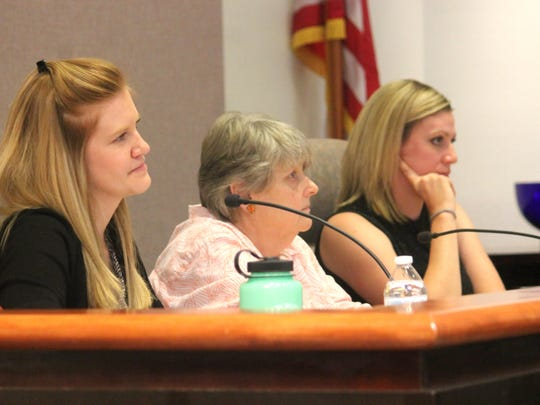 In this file photo, acting City Manager Maggie Paluch listen to residents during a town hall meeting.