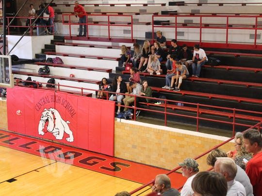 James Ball Gymnasium at Central High School, built in 1931, has eight rows of elevated bleacher seats. A brick wall surrounds the playing surface.