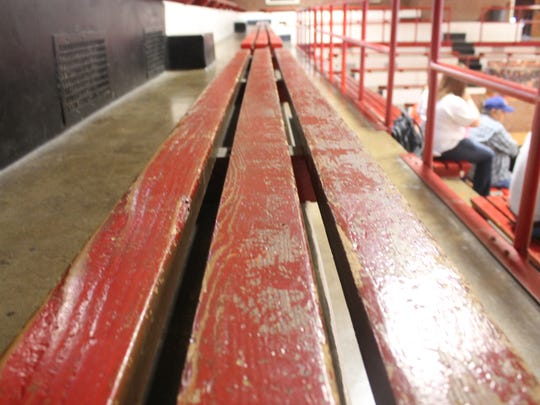 The seats at Central's James Ball Gymnasium are wooden bleachers set in concrete.