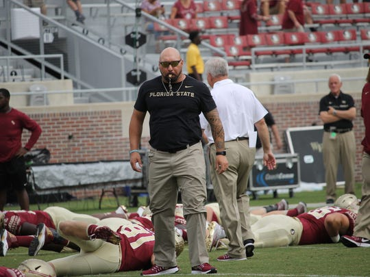 Florida State strength and conditioning coach Vic Viloria conducts the pregame stretching before the Wake Forest game.