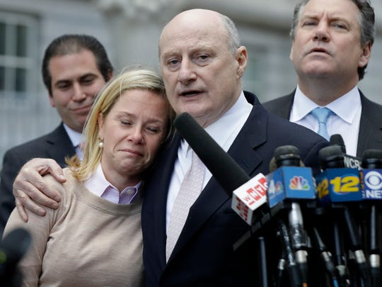 Bridget Anne Kelly, left, former Deputy Chief of Staff for New Jersey Gov. Chris Christie, is held by her lawyer Michael Critchley while talking to reporters after she was found guilty on all counts in the George Washington Bridge traffic trial at Martin Luther King, Jr., Federal Court, Friday, Nov. 4, 2016, in Newark, N.J. (AP Photo/Julio Cortez)