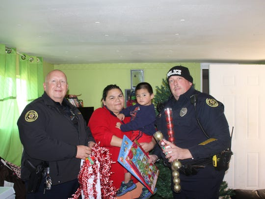 Officer Tracy Braley, Ms Embila and her 2-year-old,