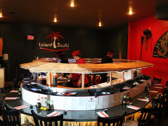 Sushi arrives on tiny boats at Island Sushi, De Pere.