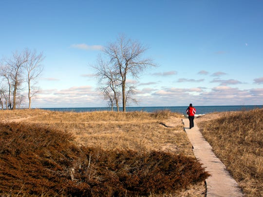 A wooden boardwalk leads to the six-mile shoreline