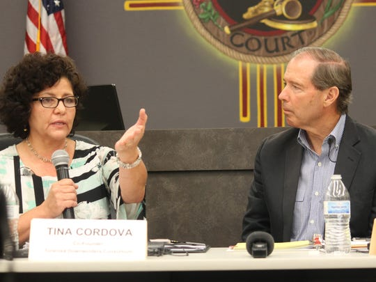 In this file photo from July 2015, Tularosa Basin Downwinders Co-Founder Tina Cordova speaks to Sen. Tom Udall about their belief that the Trinity test changed the gene pools of residents in surrounding communities.