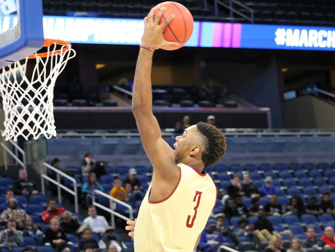 FSU guard Trent Forrest lays a ball up during the open