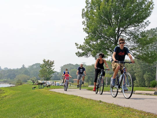A family rides along the Mariners Trail just north of Manitowoc.