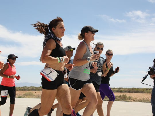 "Runners for the group ""Fasteroids"" meet up on the spaceway before crossing the finish line at Spaceport America for inaugural Spaceport America Relay Race on Sunday, April 9, 20 17."