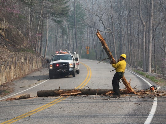 Crews clear debris on Va. 39 near Goshen Pass on Wednesday, April 12, 2017.