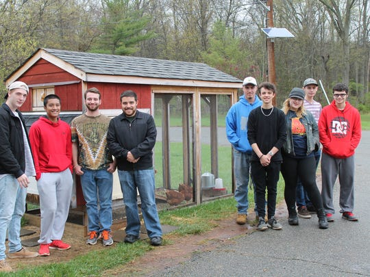Left to right: Carpentry students who worked on the chicken coop Ethan Fleming of Bridgewater, Rayden Canuel of Raritan, Brian DeBias of Branchburg, and Stephen Dutko of Watchung stand with Agricultural Science students Alex Norz of Hillsborough, Zachary Pawlikowski of Bridgewater, Natasha Thurmond of South Bound Brook, Russell Tenzer of Martinsville, and Sylvester LaBrunda of Bedminster.