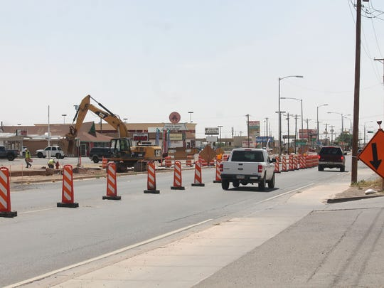 Crews work up against traffic to construct the eastbound lanes of First Street.