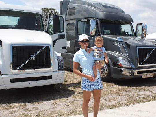 Christine Taylor and Oliver enjoyed the big trucks on display.