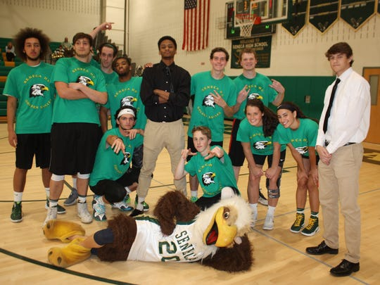 "Seneca High School seniors are shown at a benefit basketball game where they faced New Jersey State Police. The game raised funds for ""Prom House 110 Carranza"", a post-prom event the school hosts as a safe alternative for prom goers after the prom ends."