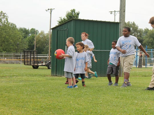 Several of the kids who participated prepare to play ball.