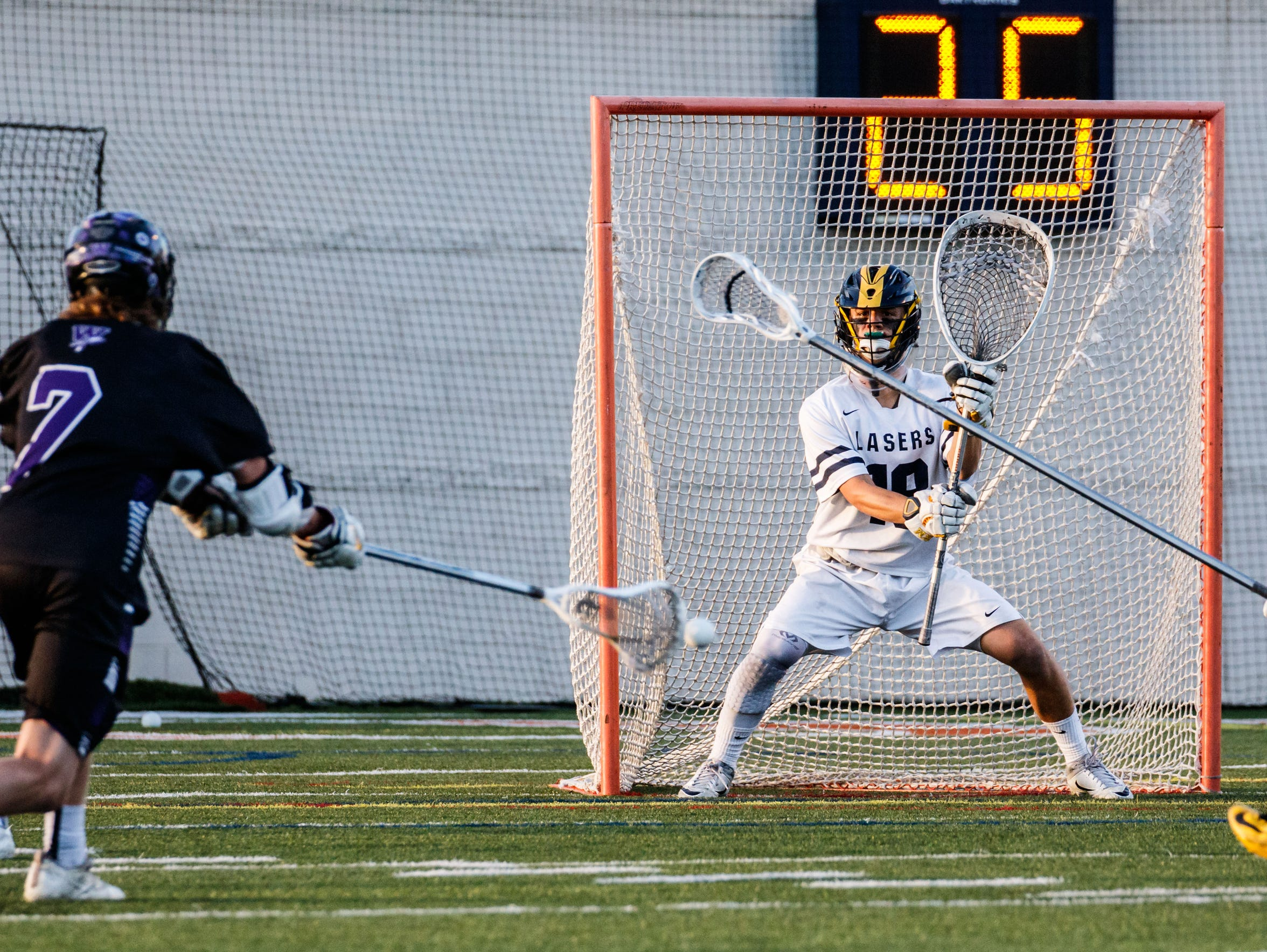 Kettle Moraine goalie Sam Shaver protects the net during