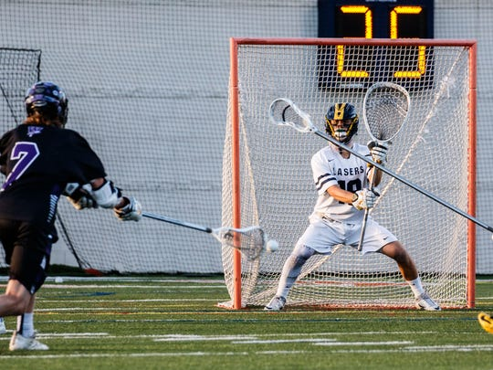 Kettle Moraine goalie Sam Shaver protects the net during the 2017 Wisconsin Lacrosse Federation D1 State Championship game against Waunakee at Carroll University on Saturday, June 10, 2017.